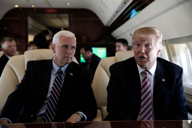 File- Republican presidential nominee Donald Trump and his running mate Indiana Governor Mike Pence speak to reporters aboard Trump's plane as they travel between campaign stops in Ohio, US, on September 5, 2016. Photo: Reuters