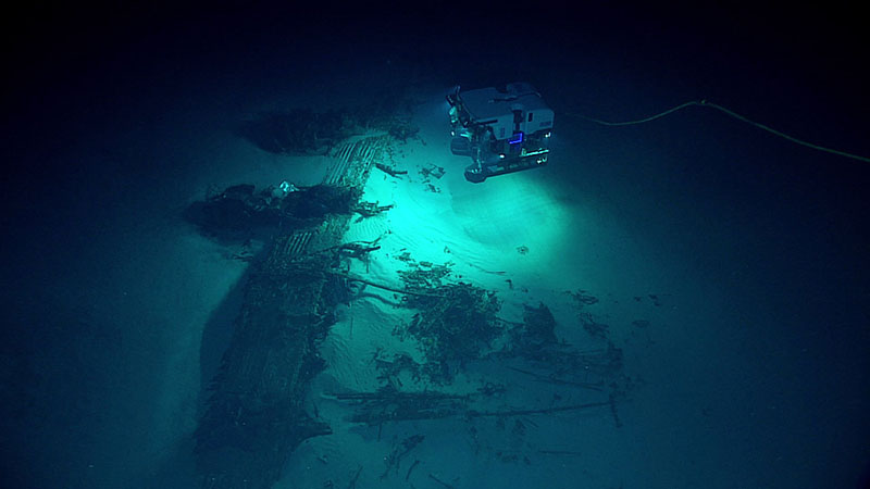 The remote operated vehicle Deep Discoverer examining the wreckage of a B-29 Superfortress bomber plane upside-down on the seafloor during a deepwater exploration of the Marianas Trench Marine National Monument area in the Pacific Ocean near Guam and Saipan, on July 9, 2016. Photo: NOAA Office of Ocean Exploration and Research via AP