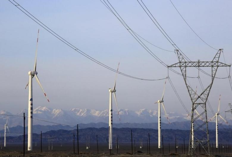 An electricity pylon is seen next to wind turbines at a wind power plant in Hami, Xinjiang Uighur Autonomous Region, China, March 21, 2015.  Photo: REUTERS