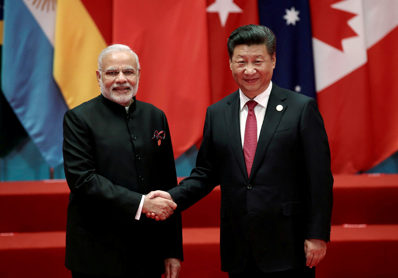 Chinese President Xi Jinping shakes hands with Indian Prime Minister Narendra Modi during the G20 Summit in Hangzhou, Zhejiang province, China September 4, 2016. Photo: Reuters