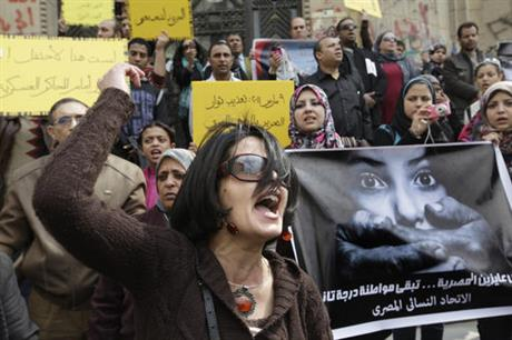 FILE - In this Friday, March 16, 2012, file photo, an Egyptian activist shouts anti-military Supreme Council slogans during a demonstration in front of Cairo's high court, Egypt. AP