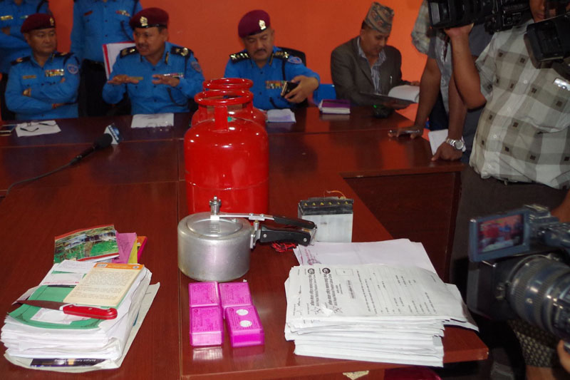 Police show various explosive devices and fliers seized from suspects of September 20 school bombing incidents, in Kathmandu, on Friday, October 21, 2016. Photo: Metropolitan Police Office