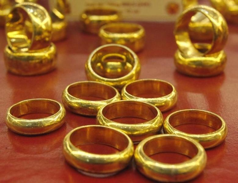 Gold products on sale are displayed at a shop in Hanoi June 11, 2013.  REUTERS/Kham