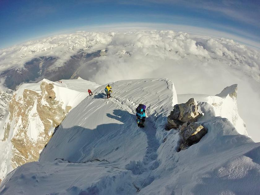 Mountaineers are seen on the summit of Mt Manaslu. Photo Courtesy: Ryan Waters/Mountain Professional/File