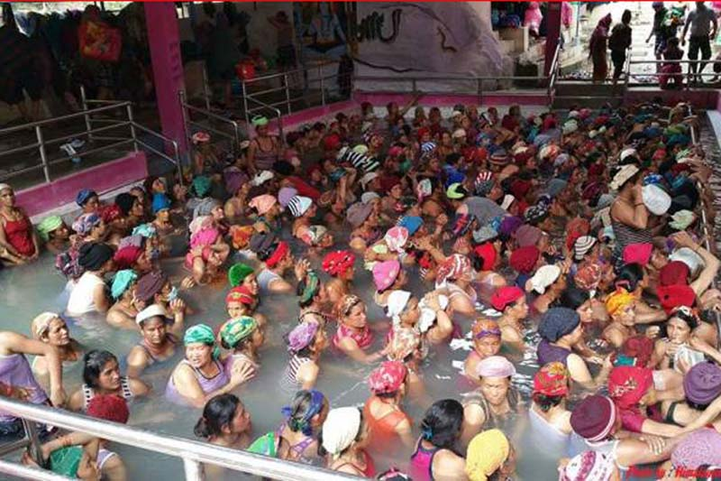 Devotees take a hot spring bath in the Tatopani Kunda in Myagdi district, on Monday, October 17, 2016. It is believed that taking a bath here heals skin, nervous and orthopaedic diseases. Photo: RSS