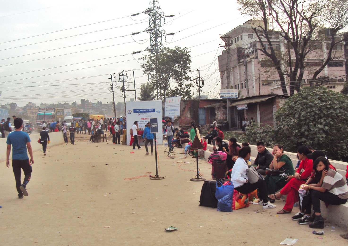 People wait for tickets to leave for their homes outside Kathmandu Valley for Dashain festival, at Balkhu, on Monday, October 10, 2016. Photo: RSS