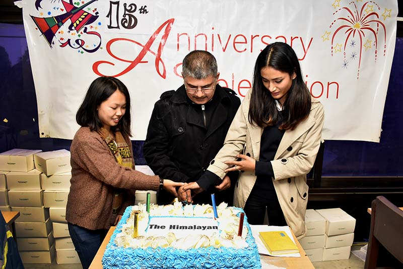 The Himalayan Times' Editor Prakash Rimal (centre) cuts the cake on the 15th anniversary celebrations of THT at its office in Anamnagar, on Wednesday, November 23, 2016. Photo: Naresh Shrestha/THT