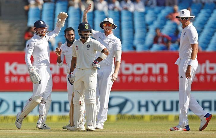 Cricket - India v England - First Test cricket match - Saurashtra Cricket Association Stadium, Rajkot, India - 12/11/16. England's Adil Rashid (2nd L) celebrates after dismissing India's Virat Kohli (C). REUTERS/Amit Dave