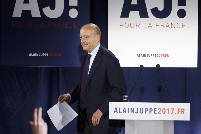 French politician Alain Juppe, current mayor of Bordeaux, and member of the conservative Les Republicains political party, reacts after partial results in the first round of the French center-right presidential primary election at his campaign headquarters in Paris, France, on November 20, 2016. Photo: Reutes