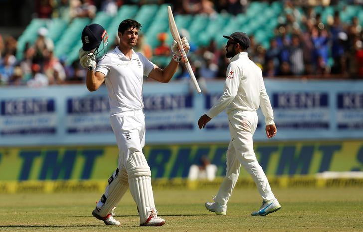 Cricket - India v England - First Test cricket match - Saurashtra Cricket Association Stadium, Rajkot, India - 13/11/16. England's captain Alastair Cook celebrates his century as his Indian counterpart Virat Kohli (R) looks on. REUTERS/Amit Dave