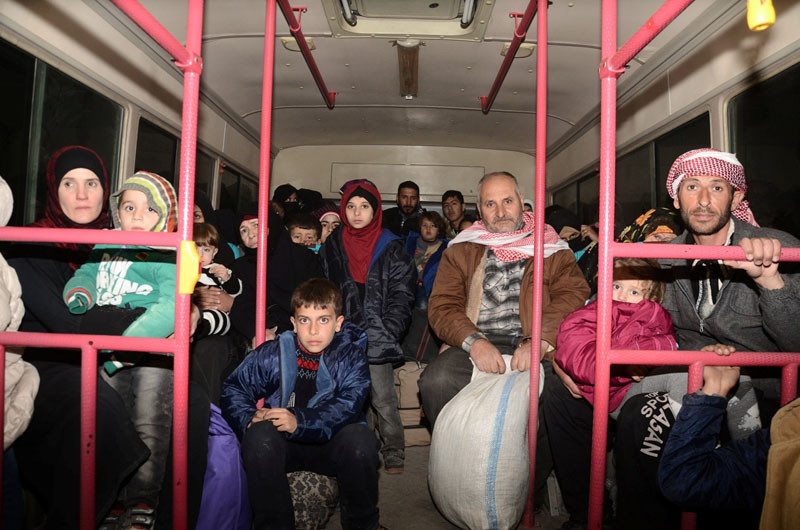 Syrians who evacuated the eastern districts of Aleppo ride a government bus in Aleppo, Syria in this handout picture provided by SANA, on November 27, 2016. Photo: SANA handout via Reuters