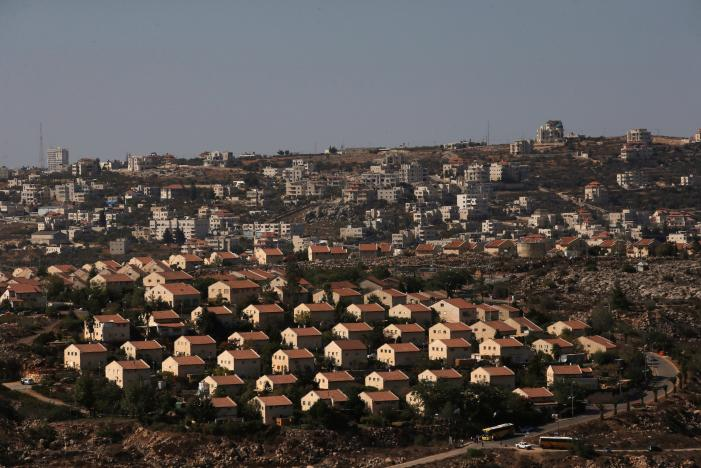 The West Bank Jewish settlement of Ofra is photographed as seen from the Jewish settler outpost of Amona in the West Bank, during an event organised to show support for Amona which was built without Israeli state authorisation and which Israel's high court ruled must be evacuated and demolished by the end of the year as it is built on privately-owned Palestinian land, October 20, 2016. REUTERS/Ronen Zvulun