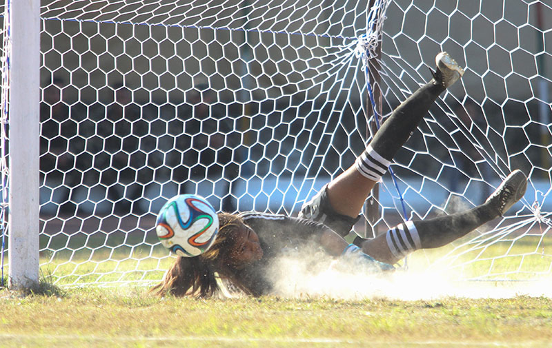Central Region goalkeeper Anjana Rana Magar dives to save a penalty against Tribhuvan Army Club during the semi-final match of the CoAS fourth International Womenu2019s Football Tournament at the Nepali Army Sports Complex in Lalitpur on Monday, November 7, 2016. Photo: Naresh Shrestha/THT