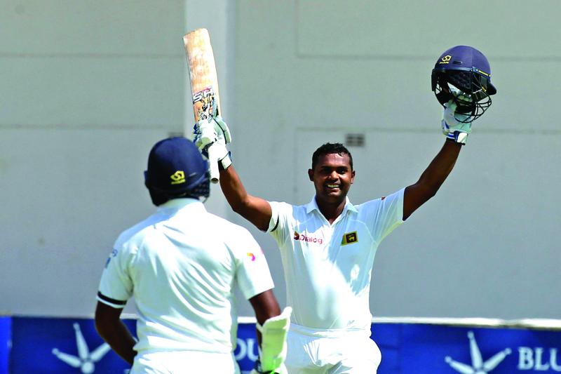 Sri Lanka batsman Asela Gunaratne celebrates after scoring 100 runs during the cricket match against Zimbabwe at Harare Sports Club in Harare, Monday, Nov, 7, 2016. Photo: AP