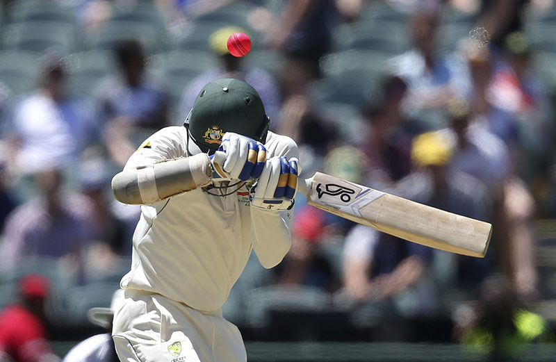Australia's Mitchell Starc ducks under a high delivery from South Africa during their cricket test match in Adelaide, Australia, on Saturday, November 26, 2016. Photo: AP