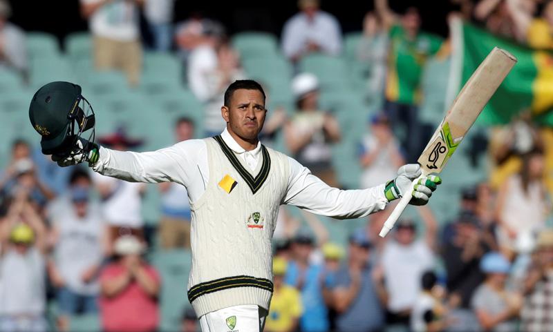 Australian batsman Usman Khawaja celebrates scoring his 100 runs century during the second day of the Third Test cricket match in Adelaide. Photo: Reuters