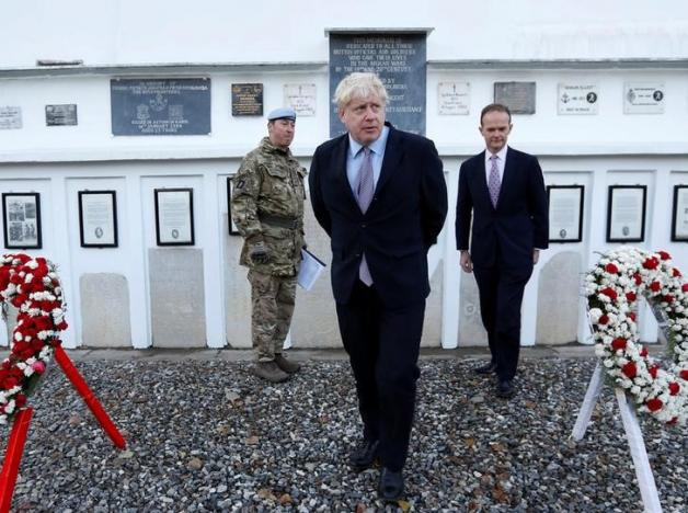Britain's Foreign Secretary Boris Johnson (C) and British ambassador to Afghanistan Dominic Jermey (R) visit the British cemetery in Kabul, Afghanistan November 26, 2016. REUTERS/Mohammad Ismail