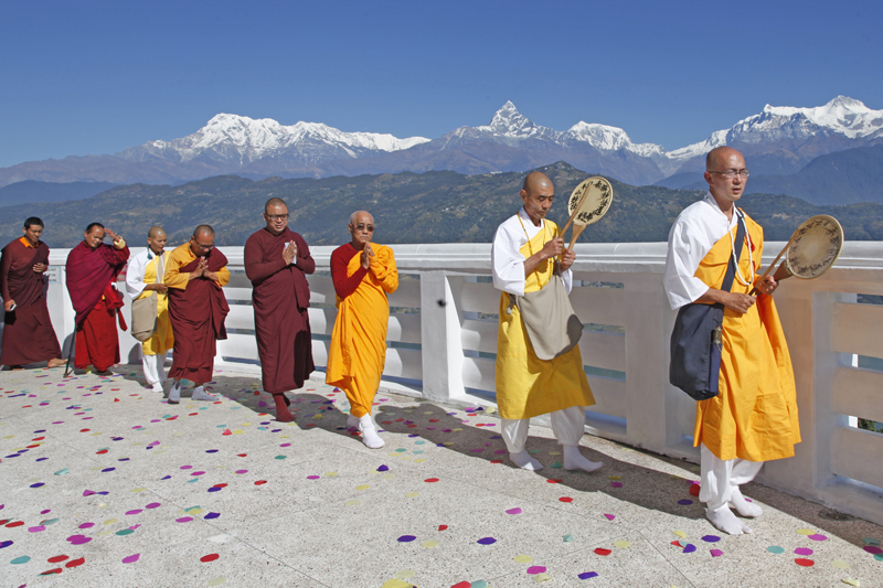 Buddhist monks walk around the World Peace Pagoda in Pokhara of Kaski during a religious function, on Saturday, November 5, 2016. Photo: Bharati Koirala