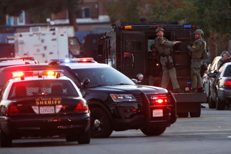 Police officers are seen at the scene of a shooting near a polling station, in Azusa, California, US, on Tuesday, November 8, 2016. Photo: Reuters