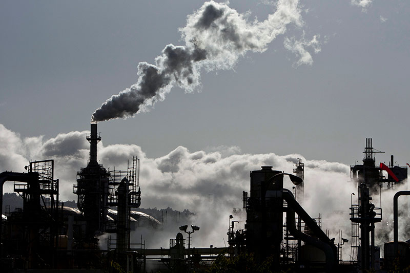 File- Smoke is released into the sky at a refinery in Wilmington, California March 24, 2012. Picture taken March 24, 2012. Photo: REUTERS