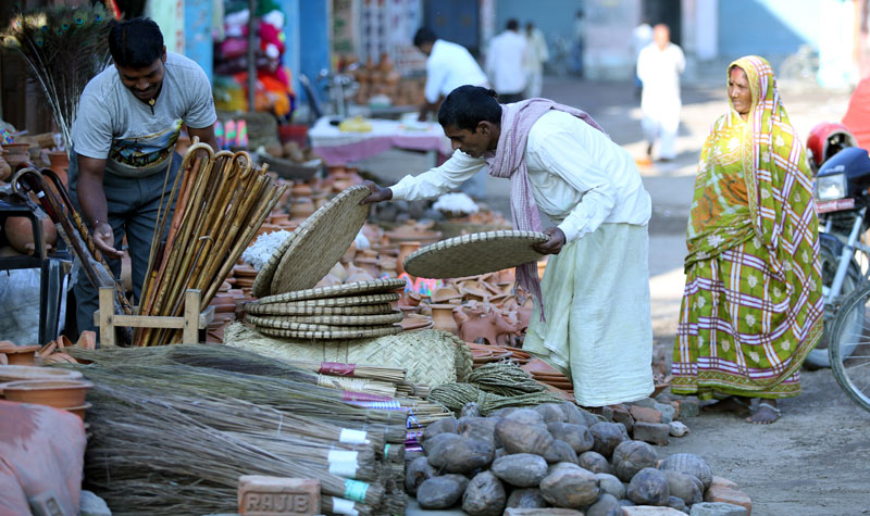 A man buys necessary items to celebrate the Chhath festival in Janakpur of Dhanusha district on Saturday, November 5, 2016. People in the Tarai region of Nepal are celebrating the annual festival worshipping the Sun God on Sunday. Photo: RSS