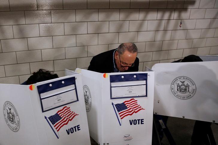 U.S. Senator Chuck Schumer (D-NY) fills out his ballot at PS 321 in the Brooklyn borough of New York City, U.S., November 8, 2016.  REUTERS/Brendan McDermid