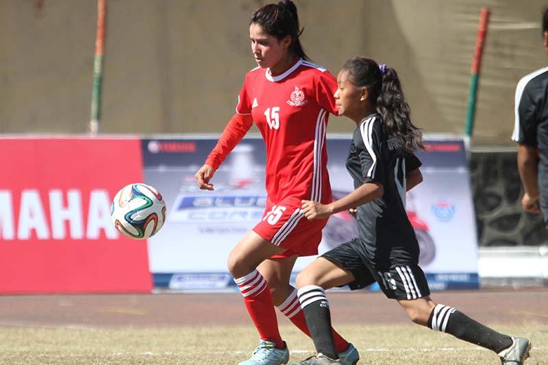 APF's Anita Basnet (right) vies with Western's Udaya Thapa during their CoAS fourth International Women's Football Tournament match in Lalitpur, on Saturday, November 5, 2016. Photo: THT