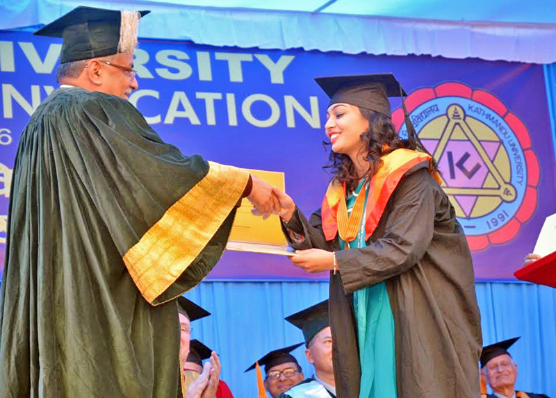 Prime Minister Pushpa Kamal Dahal felicitating a medical graduate on the occasion of the Convocation Day of Kathmandu University, in Dhulikhel, Kavre, on Tuesday, November 22, 2016. Photo: THT