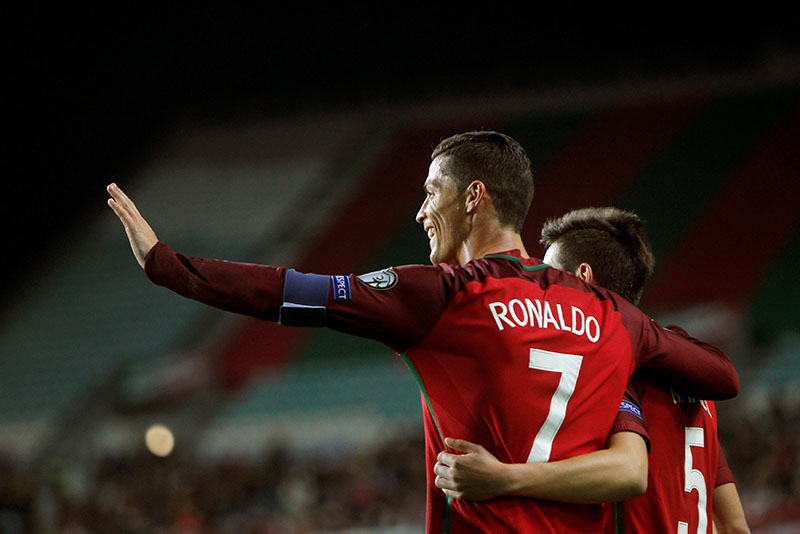 Portugal's Cristiano Ronaldo celebrates after scoring a goal during the 2018 World Cup group B qualification soccer match between Portugal and Latvia at the Algarve Stadium in Faro, Portugal, on Sunday, November 13, 2016. Photo: Reuters