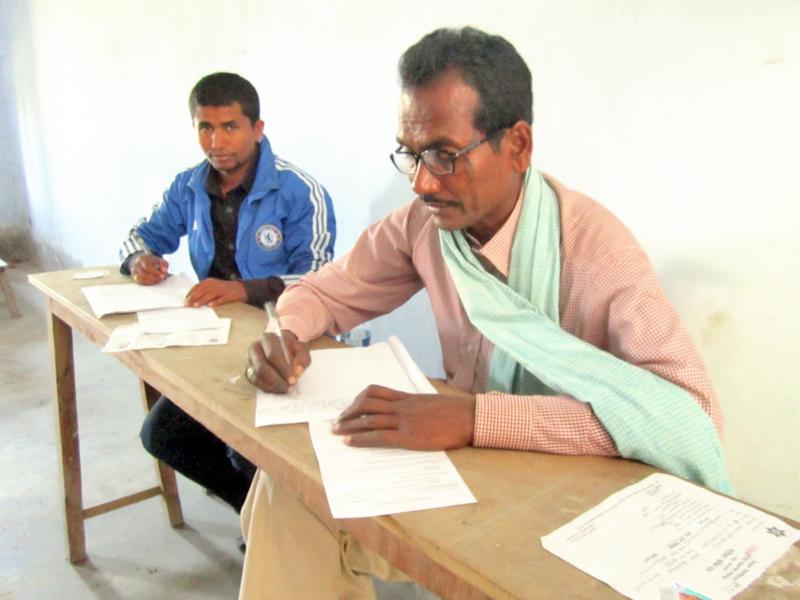 Dalit leader Yuktilal Marik (right) taking examinations of LLB, in Mahendra Bindeshwori Campus, Rajbiraj, Saptari, on Wednesday, November 16, 2016. Photo: THT