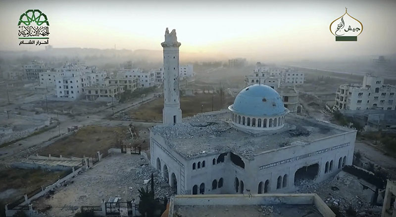 A damaged mosque in an Assad neighborhood of Aleppo, Syria. Syrian government forces launched a counteroffensive on Saturday, October 29, 2016, under the cover of airstrikes in an attempt to regain control of areas they had lost to insurgents the day before in the northern city of Aleppo, activists and state media said. Photo: Ahrar al-Sham, militant video, via AP