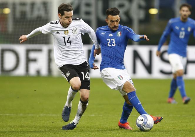 Football Soccer - Italy v Germany - International Friendly Match - San Siro Stadium, Milan, Italy - 15/11/16 - Italy's Davide Astori and Germany's Sebastian Rudy in action .  REUTERS/Alessandro Garofalo