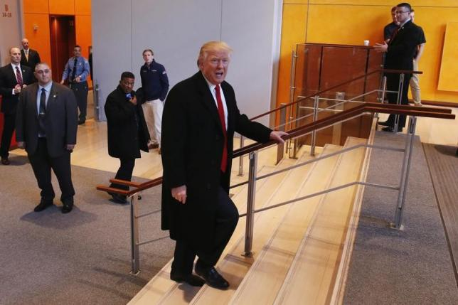 US President elect Donald Trump walks up a staircase to depart the lobby of the New York Times building after a meeting in New York, US, on November 22, 2016. Photo: Reuters