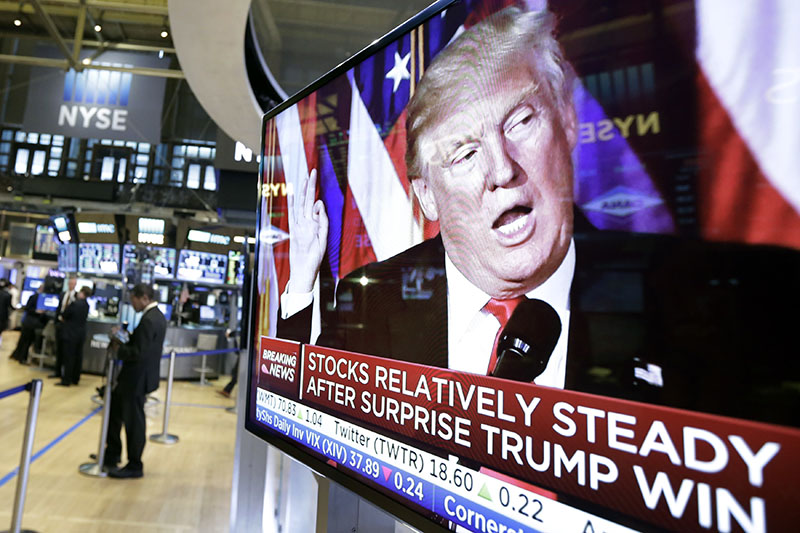 An image of President-elect Donald Trump appears on a television screen on the floor of the New York Stock Exchange, on Wednesday, November 9, 2016. Photo: AP