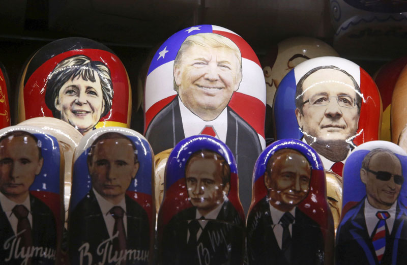 Painted Matryoshka dolls, or Russian nesting dolls, bearing the faces of US Republican presidential nominee Donald Trump, German Chancellor Angela Merkel, French President Francois Hollande and Russian President Vladimir Putin are displayed for sale at a souvenir shop in central Moscow, Russia, on November 7, 2016. Photo: Reuters