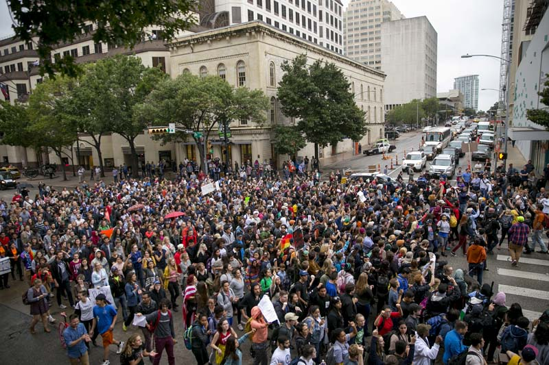 Anti-Trump protesters march along Congress Avenue in Austin, Texas, on Wednesday, November 9, 2016. Photo: AP