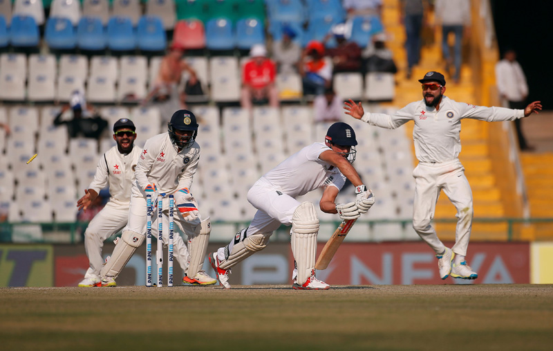 England's Alastair Cook (2-R) is bowled. Photo: Reuters