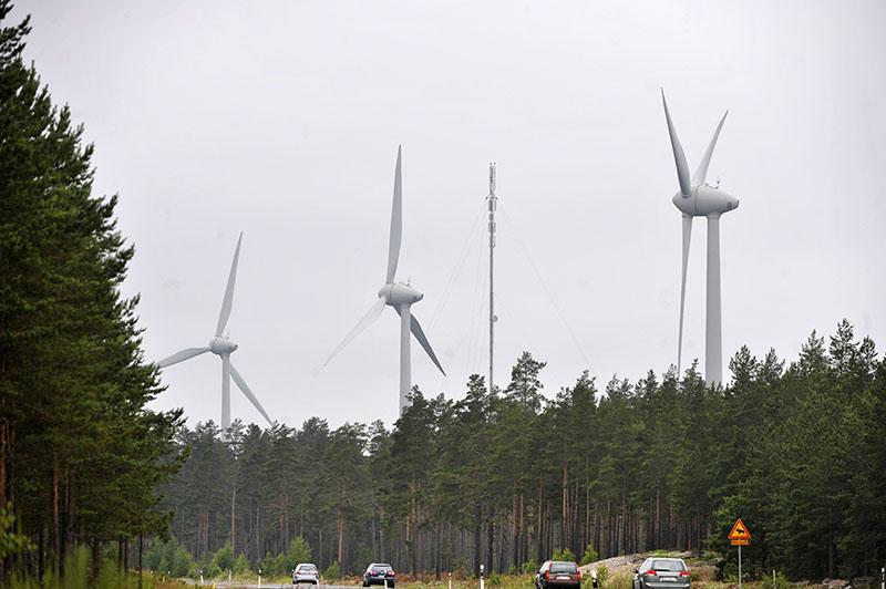 FILE- Cars drive past a group of windmills in Hanko, Finland, on July 8, 2009. Photo: Vesa Moilanen/Lehtikuva via AP