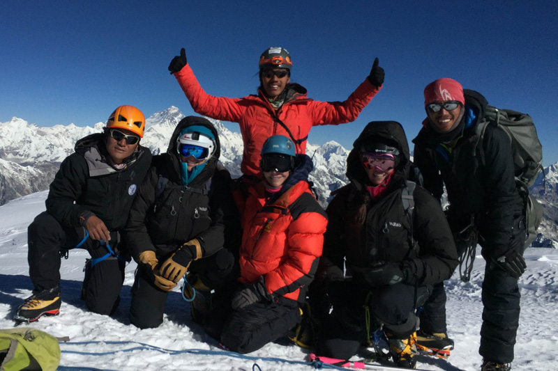 Climbers pose for a photograph as they climb the Mt Khang Karpo (6,646 metres) becoming the first expedition atop one of the virgin peaks of the Rolwaling Valley in Dolakha district of central Nepal, on November 10, 2016. Photo: Nima Tenji