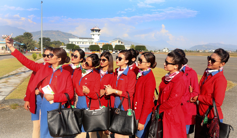 Aspiring flight attendants pose for a selfie in Pokhara airport, on Tuesday, November 22, 2016. Photo: RSS