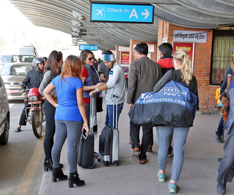 Relatives visit their loved ones as they prepare to depart for various foreign countries, at the Tribhuvan International Airport in Kathmandu, on Wednesday, November 9, 2016. Photo: RSS