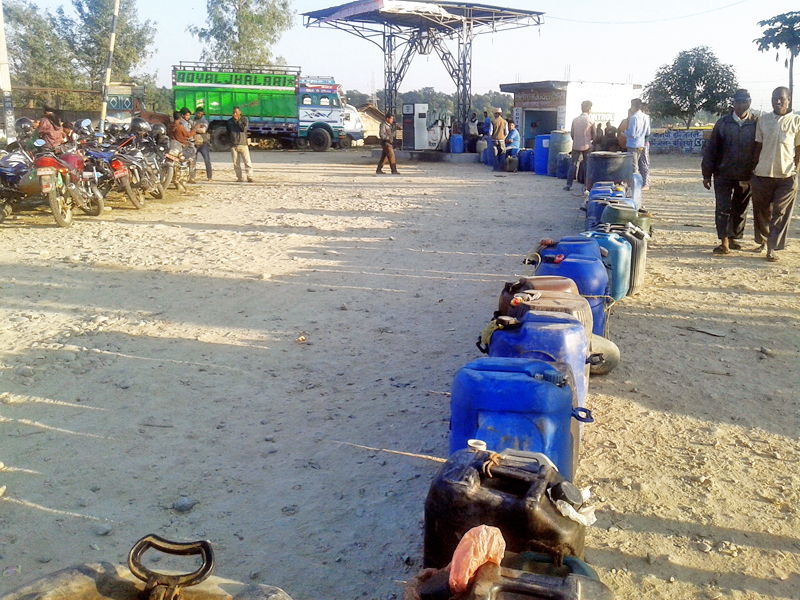 Customers are compelled to put their jerry cans in a line to fill petrol from a nearby petrol pump in Kanchanpur district, on Wednesday, November 16, 2016. For last two weeks, the short supply of petroleum products has created a crisis in the district.  Photo: RSS