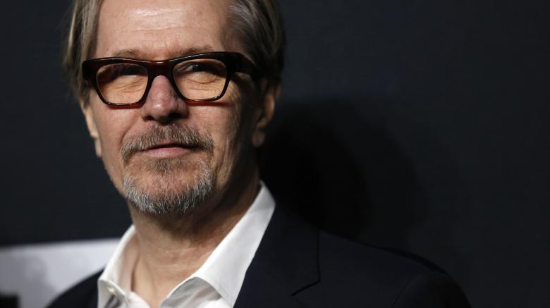 Actor Gary Oldman poses as he arrives for the Saint Laurent fall collection fashion show at the Hollywood Palladium in Los Angeles, California February 10, 2016.   REUTERS/Mario Anzuoni/File Photo