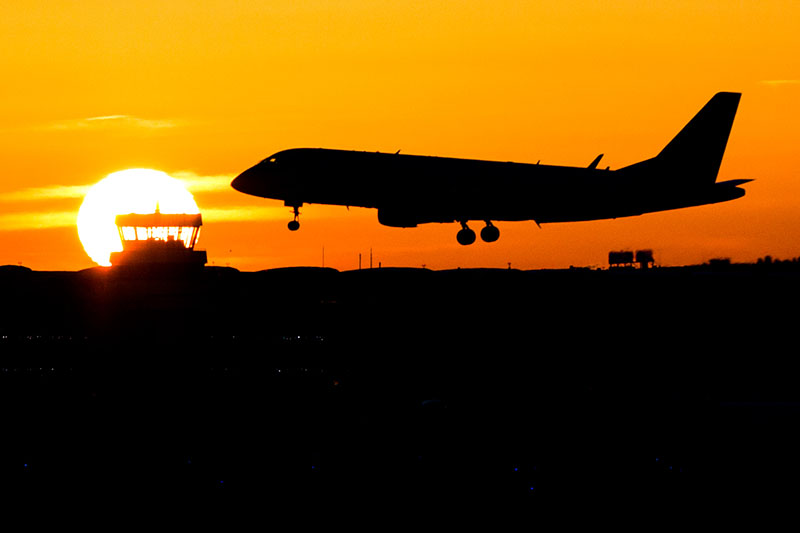 A plane lands during sunrise at the airport in Duesseldorf, Germany on Friday, November 25,  2016.  Lufthansa pilots will continue their strike at least until Saturday.Photo: AP