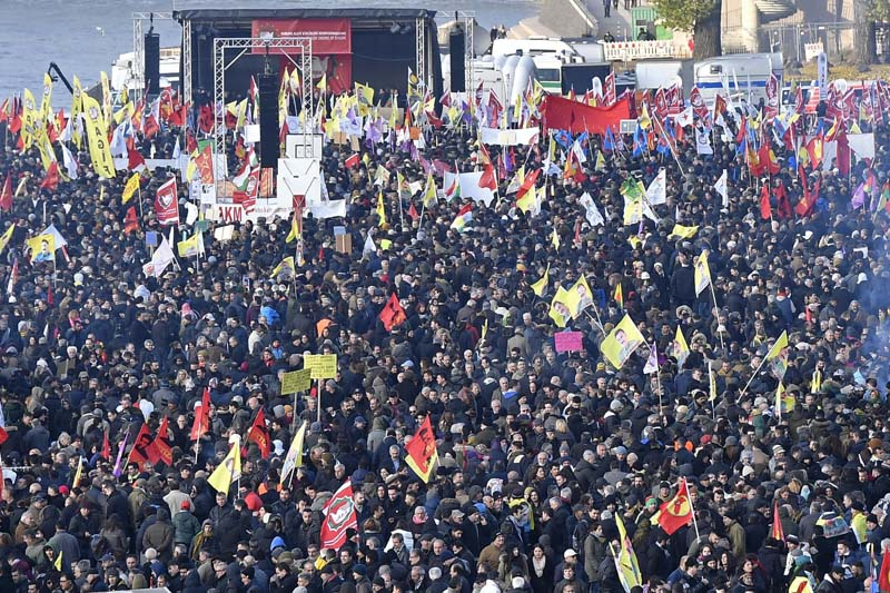 Pro-Kurdish demonstrators protest against Turkish president Recep Tayyip Erdogan and the political repression that followed July's failed military coup, in Cologne, Germany, on Saturday, November 12, 2016. Photo: AP