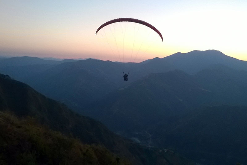 Tourists enjoy paragliding in Gulmi and observe tourist areas along with Malikadevi temple on Tuesday, November 15, 2016. Photo: RSS