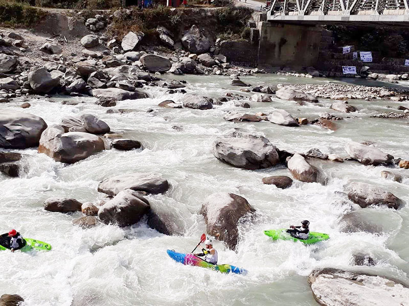 Participants try to control their kayaks during the Boater Cross event under the Himalayan Water Challenge 2016 at the Seti River in Pokhara on Tuesday, November 29, 2016. Photo courtesy: Milan Tiwari