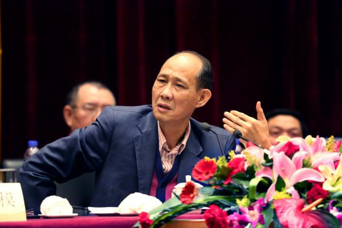 Huang Rulun, head of Century Golden Resources Group attends a meeting in Lianjiang, Fujian province, China, February 4, 2014. Picture taken February 4, 2014. REUTERS/Stringer