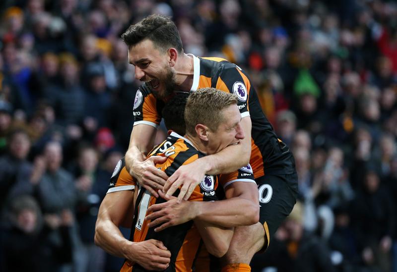 Hull City's Michael Dawson celebrates scoring their second goal with Robert Snodgrass. Photo: Reuters