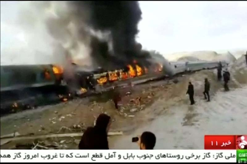 People gather around two passenger trains that collided in the city of Shahroud, in the north-central province of Semnan, killing several people, in this still frame taken from video, on Friday, November 25, 2016. Photo: Reuters